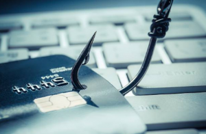 sharp fish hook going into credit card and keyboard for phishing