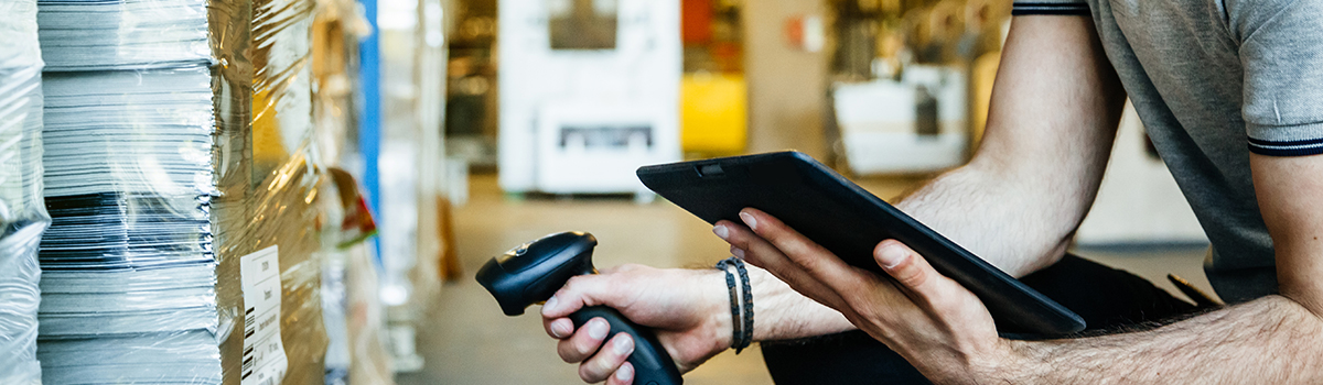 image of person scanning a box with barcode scanner